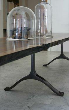 Slab table with cast bronze wishbone base - BDDW (designer Tyler Hays)