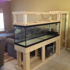 Captivating fish tank room divider with tile flooring and gray sofa for modern home design idea