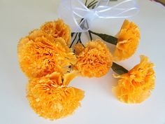 Crepe paper carnations would be perfect for filler flowers that still make a big statement!