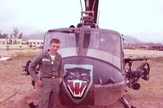 """A Huey gunship from the 213th Assault Support Helicopter Company """"Black Cats""""."""
