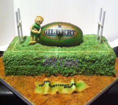 """Rugby themed cake on a 14"""" pitch"""