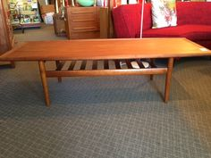 "Greta Jalk Teak Coffee Table with Shelf, Danish mid century modern, $699, L63"", W23"" A really beautiful mid century modern coffee table - put it in front of your three seater couch!"