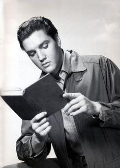 Elvis reads.