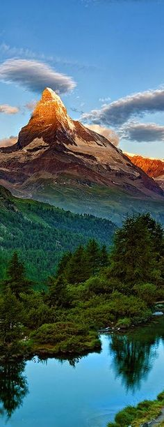 On the border of Switzerland and Italy lies Matterhorn (aka Monte Cervino), Europe's mountain. With one of the highest peaks of the iconic Swiss Alps, Matterhorn is an attraction for both climbers and photographers. Places To Travel, Places To See, Travel Destinations, Places Around The World, Around The Worlds, Beautiful World, Beautiful Places, Landscape Photography, Nature Photography