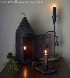 warm candlelight - hallway table  I have3 different small tables just this in my Home. One in the entrance, One in the Guest Room and one in the Bath Room. The wall color behind this arrangement makes is look so wonderful. Guess I should have a look at my three spots today and maybe makes some changes here and there. Thank you for sharing ~