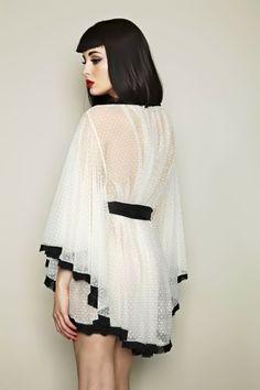 This looks like a super cute dressing robe. I wants.