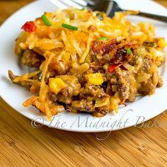 Mexicali Hashbrown Taco Casserole | bakeatmidnite.com | #casseroles #tacos #mexican