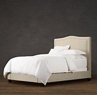 RH's Latham Fabric Bed:A classic shape with a subtle camelback makes Latham a versatile choice.
