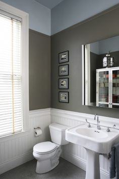 Another cool bathroom with wainscoting. In a small bathroom, I prefer a pedestal sink - it takes up a lot less visual space. I like this classic sink and toilet. The paint makes this room feel masculine, too. Basement bathroom painting?
