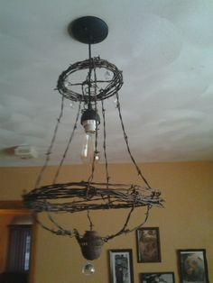 barbed wire chandelier... Wire Basket Chandelier, Barbed Wire Decor, Recycled Metal Art, Barn Tin, Diy Sofa, Unique Lighting, How To Make Light, Western Decor, Mirror With Lights