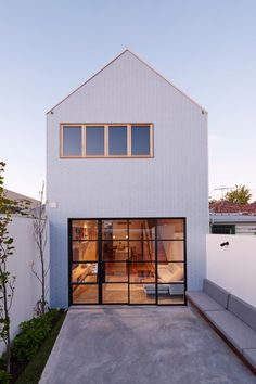 Pastel blue tiles front gabled extension to a Melbourne house by Dan Gayfer Design