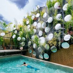 Madrid swimming pool updated by Manuel Ocaña with mist, mirrors and plants