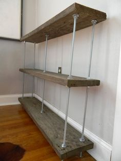 Bookshelf with reclaimed wood and threaded rods.