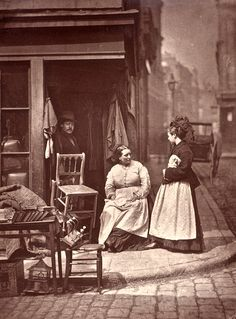 """Old Furniture Seller in Holborn – """"As a rule,  second-hand furniture men take a hard and uncharitable view of humanity. They are accustomed to the scenes of misery, and the drunkenness and vice, that has led up to the seizure of the furniture that becomes their stock.""""  From John Thomson's Street Life in London"""