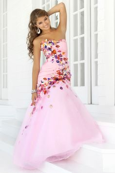 Stunning Pageant gown! Colorful printed rosettes drape your body to create a stunning silhouette.