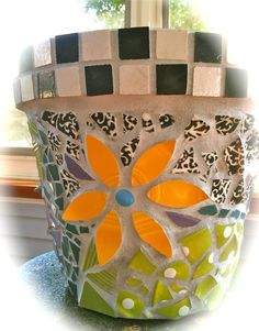 My First time to mosaic a large clay garden pot. Good learning experience.