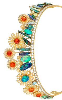 Modern, one of a kind opal, emerald, and diamond tiara set in gold. Designed by Irene Neuwirth for Joanna Newsom's wedding to comedian Andy Samberg in 2013.