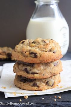 Stack of chocolate chip walnut cookies laying on a white napkin that is sitting on a dark table with a glass jar of milk in the background Chocolate Chip Walnut Cookies, Pecan Cookies, White Chocolate Chips, Delicious Chocolate, Chocolate Flavors, Cinnamon Roll Cookies, Carob Chips, Walnut Cake, Peanut Butter Chips