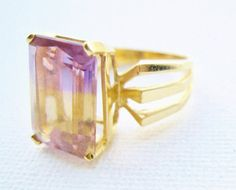 Check out this item in my Etsy shop https://www.etsy.com/listing/228306992/vintage-14k-gold-ametrine-solitaire