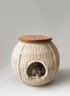barcelona product designer Laia created this beautiful set of objects - a nightstand-house, a feeder to share human leftovers and a toy. All are made of natural materials, such as wicker, ceramics and wood and crafted in Catalonia.