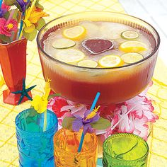 "Luau party ideas - punch bowl and colorful cups. Use the ""flower"" shaped ice cubes frozen in the bottom of a 2 liter bottle (see pin above)"