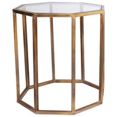 An octagon shaped side table with an antiqued brass metal frame and an inset glass top. Consider it as an alternative to the traditional square side table, as the unusual shape means it can fit into more awkward spaces. Also available in a smaller size.