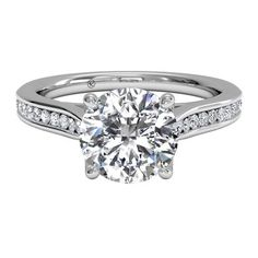 Set in enduring platinum, this handmade channel-set engagement ring is truly stunning. Available in Platinum (0.14 CTW) for a Round Center Stone