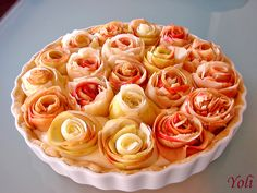 Apple Roses Pie - Crust is shortbread, filling vanilla custard, apples glazed with appricot jelly.  Bump it up with a little cinnamon in the custard.