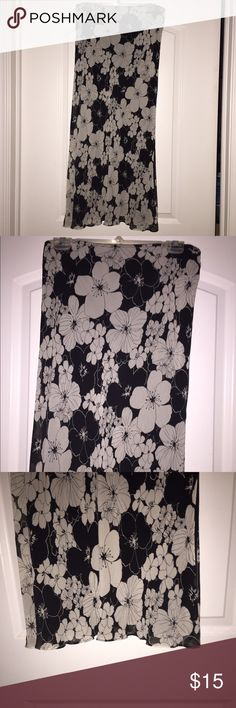 Black and White Skirt Elastic at waist. Flowy with slits up both sides. Hangs mid calf. In excellent condition. Material is 100% silk lining and 100% polyester shell. Express Skirts Midi