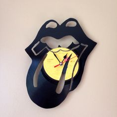 Rolling Stones lips and tongue logo record clock- come visit our shop for other bands. Or send us a custom request with your favorite band and we will do our best to make your musical art dreams come true. www.MusicAsArtBySarah.etsy.com
