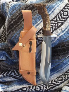 Alaska Bowie. Bowie knife with a deer antler, black walnut handle, stainless steel guard and handmade leather sheath.
