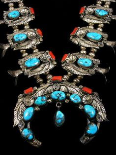 Coral and turquoise squash blossom