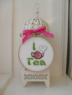 I Love Tea framed cross stitch in green and pink by YellowSherbet, £12.00