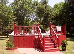 Above ground pool deck  with storage. Love the red