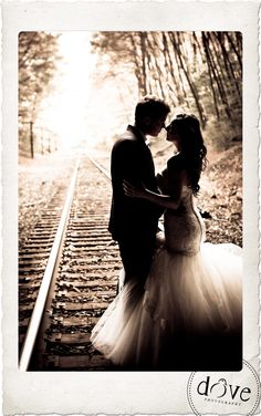 trash the dress on railroad tracks