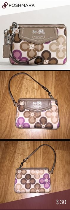 Coach Wristlet Rare authentic Coach Madison Clover print wristlet. Used only a handful a times and still has tones of life left in it! Coach Bags Clutches & Wristlets