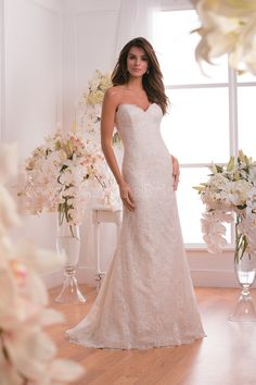 Jasmine Collection Wedding Dress Style F171004 in Ivory-Gold. Sexy and refined, this dress is the perfect outfit for an unforgettable wedding ceremony. The strapless sweetheart neckline and trumpet skirt are already stylish, but add a layer of our embroidered lace and the result is a gown to be remembered.