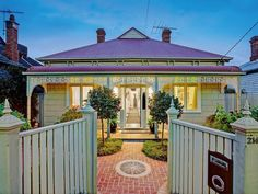 Weatherboard double fronted Victorian with Federation style porch
