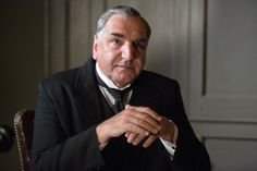 Mr Carson, The Butler. Carson is keen to get the staffing levels at Downton back up to scratch. He has kept standards as high as he could during the war years, managing without footmen and pushing himself to the limit, and he was mortified to suffer a physical breakdown in front of the family. Carson is nevertheless aware that the servant class has been changed by the war. He has to learn to accept Matthew as co-master, but he remains eternally loyal to his beloved Mary.    Played by Jim Carter