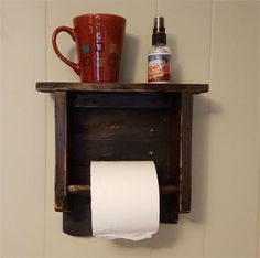 This is a black antiqued toilet paper holder wall shelf version #4. This piece features a black stain finish, distressed look and wear marks. Finished with an antique poly. The piece is 11.5 inches wide by 10 inches tall by 3.5 inches deep. Wood dowel included. Wall hangers on the back. The top can be used to put your coffee on or cell phone on. I used several new techniques that enhanced the look of it. Makes a great accent piece to any bathroom decor. It could be used as a towel rack if…
