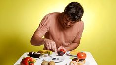 He started off by taking it easy on some blueberries. | Prince Oberyn Takes His Revenge On The Mountain — With Food