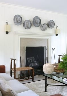 These metal hats add a whimsical feel to this rustic living room.