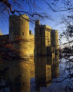 Bodiam Castle, seen across the moat, from the south west, on a crisp winter morning, The central Postern Tower was originally connected by bridge to the south bank of the moat, Sussex UK circa 1385