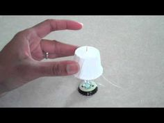 Video showing how to make a dollhouse lamp from a bottle cap, toothpick and fast food ketchup cup | Source: My Froggy Stuff