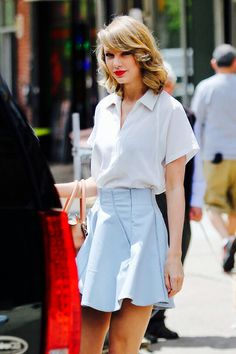 Taylor Swift ~ white collared shirt w/ pastel blue A-line skirt                                                                                                                                                                                 More