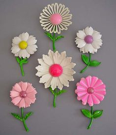 "Enamel ""flower power"" brooches - 1960s   my mom has at least 3 of these brooches. she wore them on her vest to work at Macy*S.. where she bought them...love this"