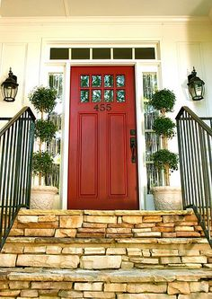 Exterior Doors | red door on a white house creates the perfect pop of color | Bayer Built Woodworks