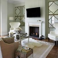 mirrors on each side of fireplace