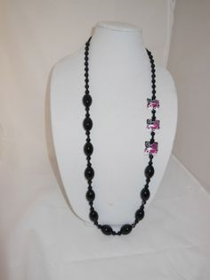 Long necklace of black agate, black onyx, pillow beads by well-known lampwork artist and fancy clasp.