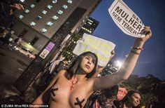 A woman is pictured protesting in Paulista Avenue in Sao Paulo as part of nationwide demonstrations